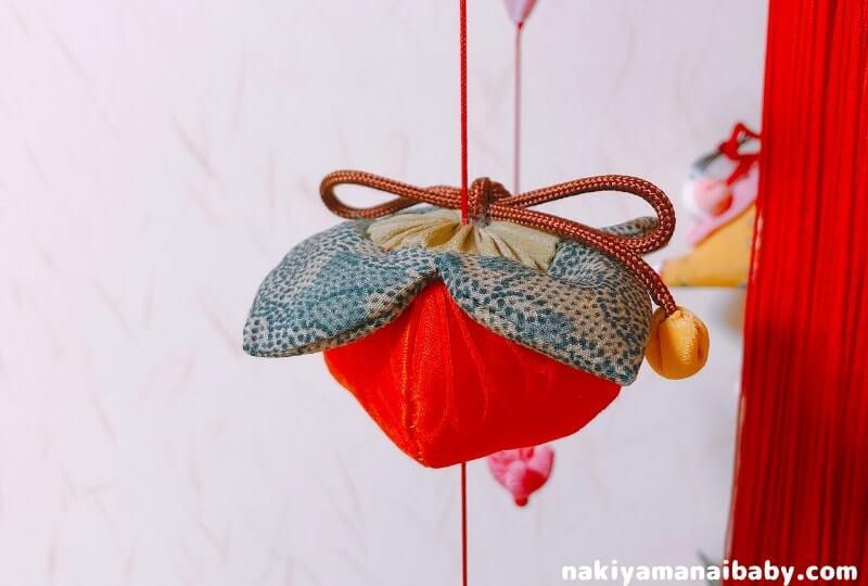 母の手作りひな祭りのつるし飾り「柿」の人形の写真