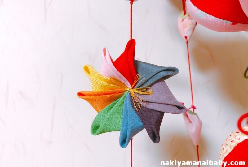 母の手作りひな祭りのつるし飾り「風車」の人形の写真
