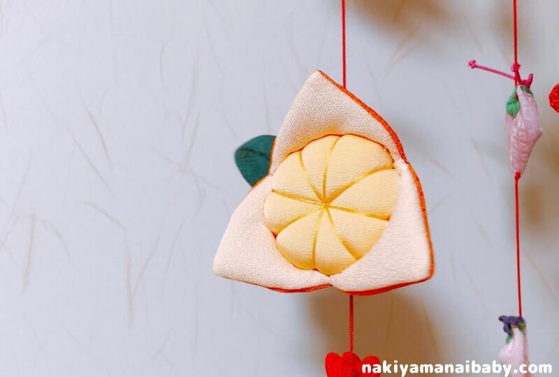 母の手作りひな祭りのつるし飾り「みかん」の人形の写真